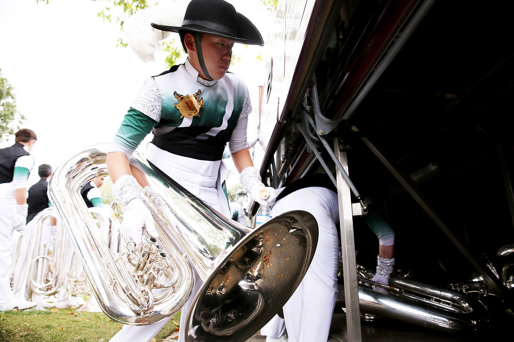 . Christopher Ng places his instrument in a bus after completing 128th Rose Parade for Santa Clara Vanguard Drum and Bugle Corps  in Pasadena, Calif. on Monday, Jan. 2, 2017. (Photo by Trevor Stamp)