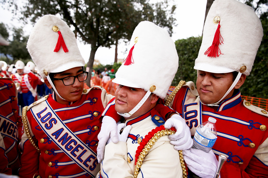 . Josue Rodriguez, center, is embraced by his band mates after completing is fourth Rose Parade for the Los Angeles All District Honor Band during the 128th Rose Parade in Pasadena, Calif. on Monday, Jan. 2, 2017. (Photo by Trevor Stamp)