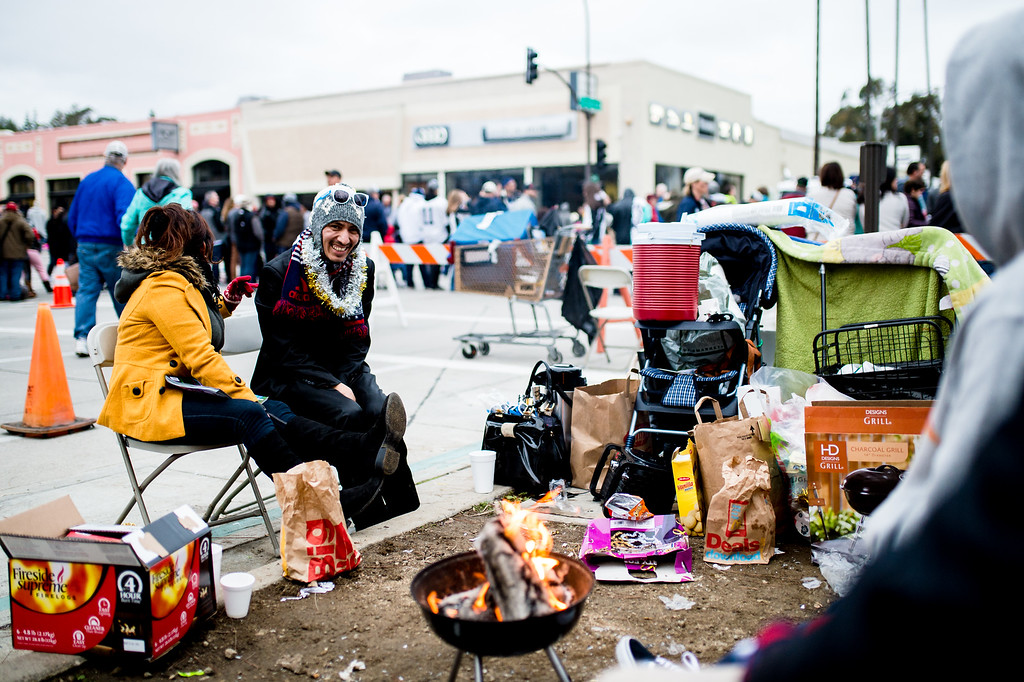 . Victor Garcia and wife, Maria, of Pasadena, camped over night along Union Street to watch the morning 2017 Rose Parade in Pasadena on Monday, January 2, 2017. (Photo by Watchara Phomicinda, San Gabriel Valley Tribune/ SCNG)