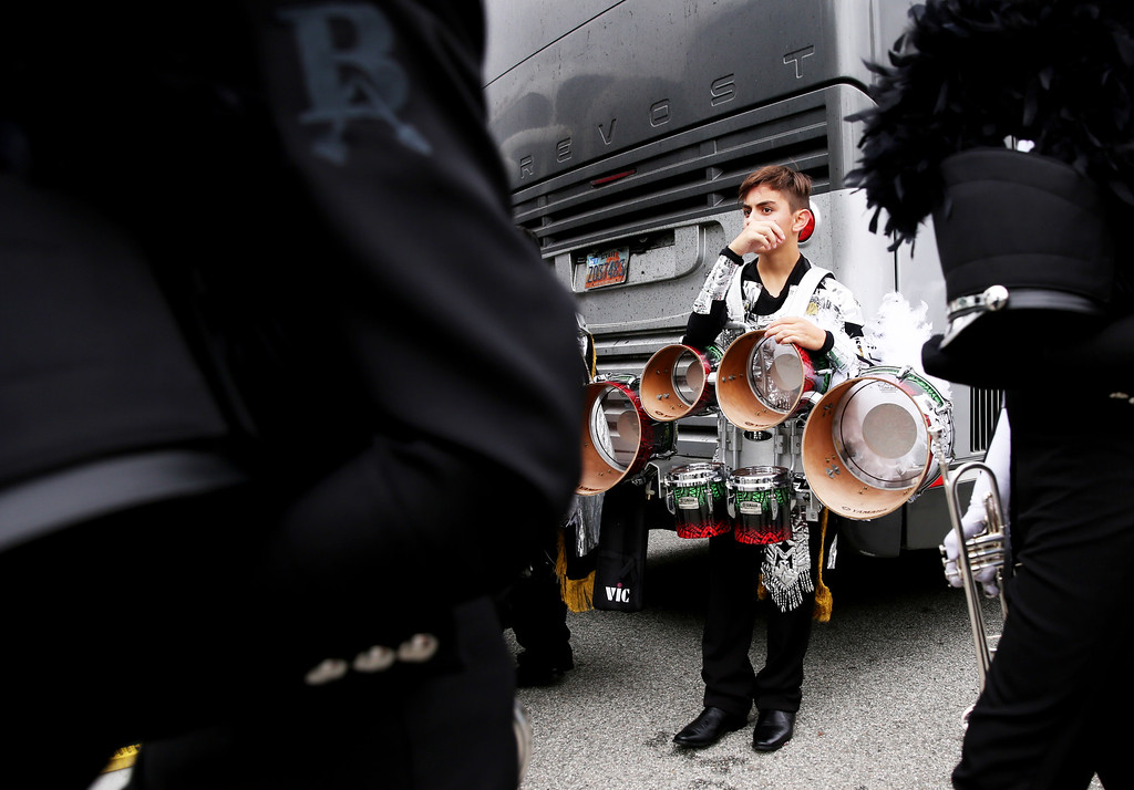 . A drummer from Mexico\'s Escuela Secundaria Tecnica Industrial No. 3, Buhos Marching Band rests after completeing the 128th Rose Parade in Pasadena, Calif. on Monday, Jan. 2, 2017. (Photo by Trevor Stamp)