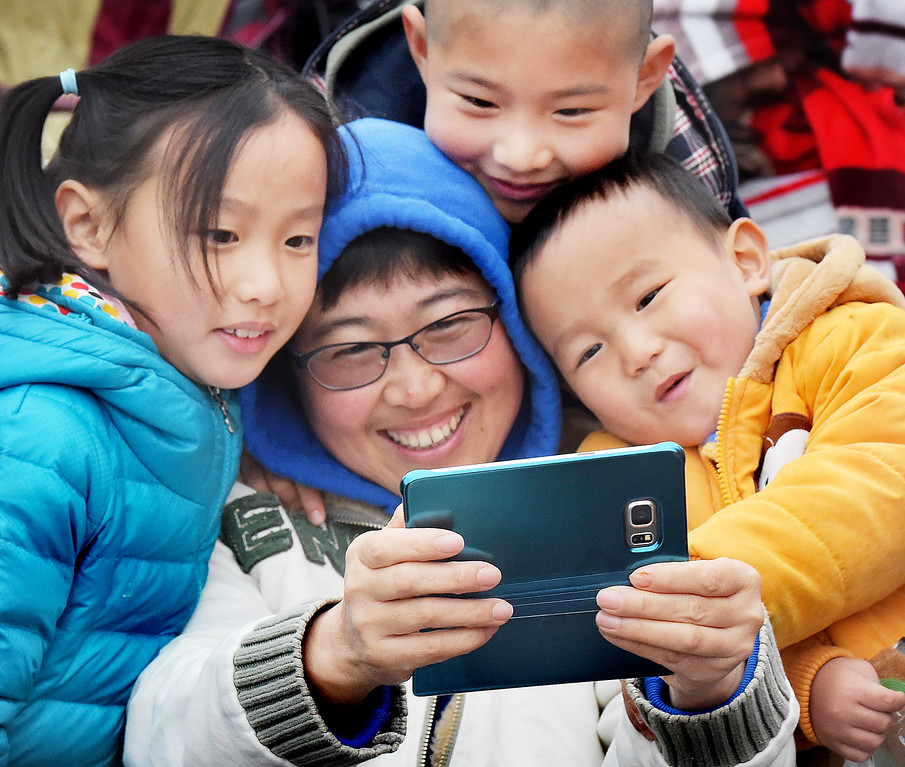""". Sandra Li  snapping a selfie before the Rose Parade, of Lydia Zhang, Brayden Zhang, and Jason Chou at 128th Rose Parade \""""Echoes of Success\"""". (Photo by Walt Mancini/SCNG)"""