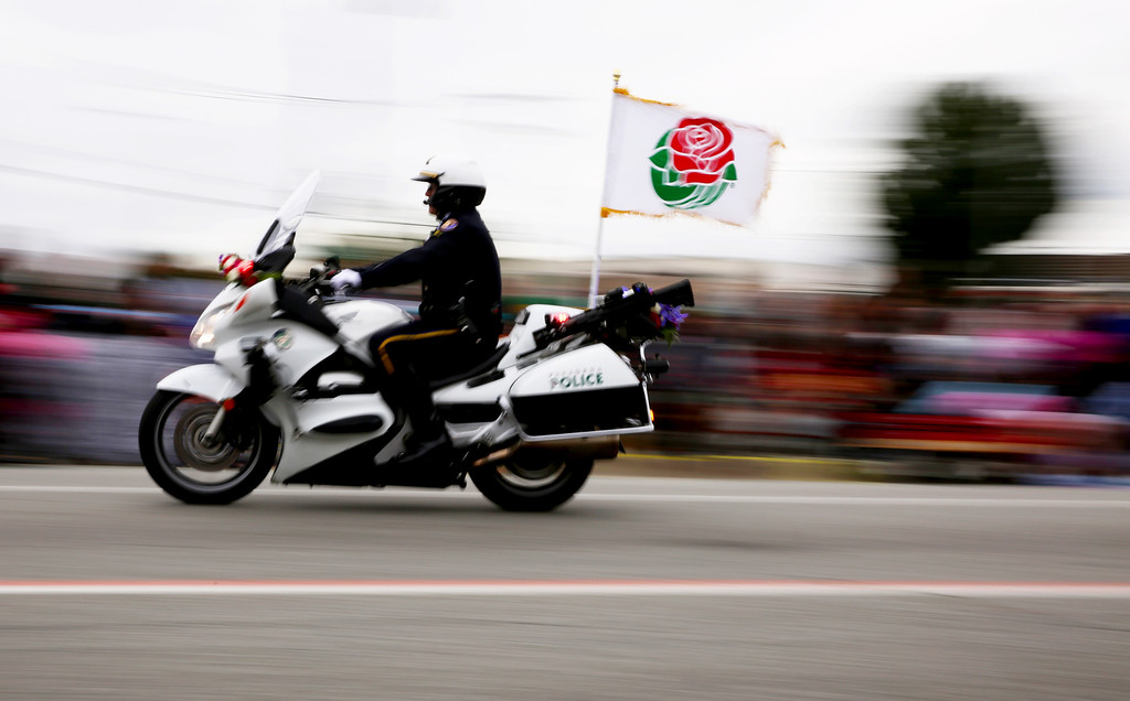 . Pasadena police speed by to lead off the the 128th Rose Parade in Pasadena, Calif. on Monday, Jan. 2, 2017. (Photo by Trevor Stamp)