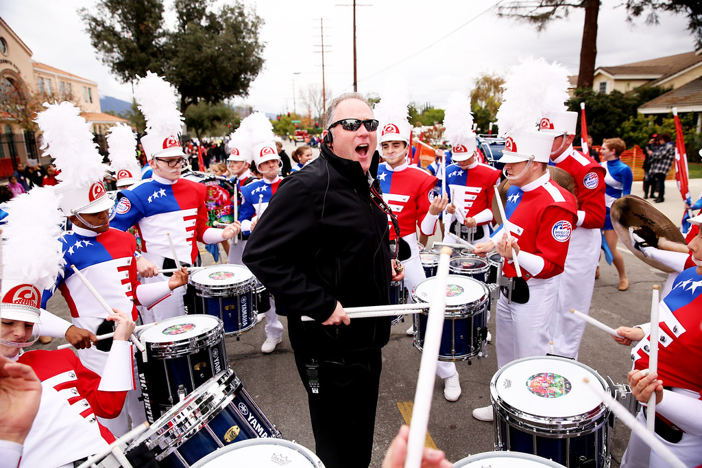 . Matt Henley, center, fires up the Bands of America Honor Band after they completed  the 128th Rose Parade in Pasadena, Calif. on Monday, Jan. 2, 2017. (Photo by Trevor Stamp)