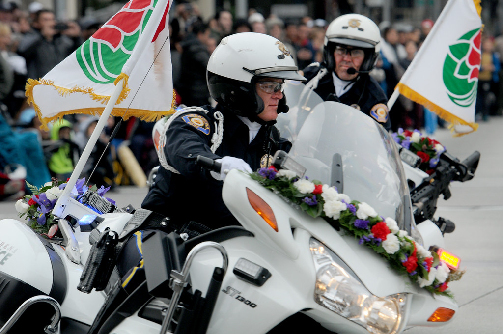 . Pasadena motorcycle officers prepare the crowd for the start of of the parade at Colorado Blvd. and Lake Ave. during the Rose Parade on Colorado Blvd. in Pasadena, Calif. on Monday, Jan. 2, 2017. (Photo by Dean Musgrove, Pasadena Star-News/SCNG)