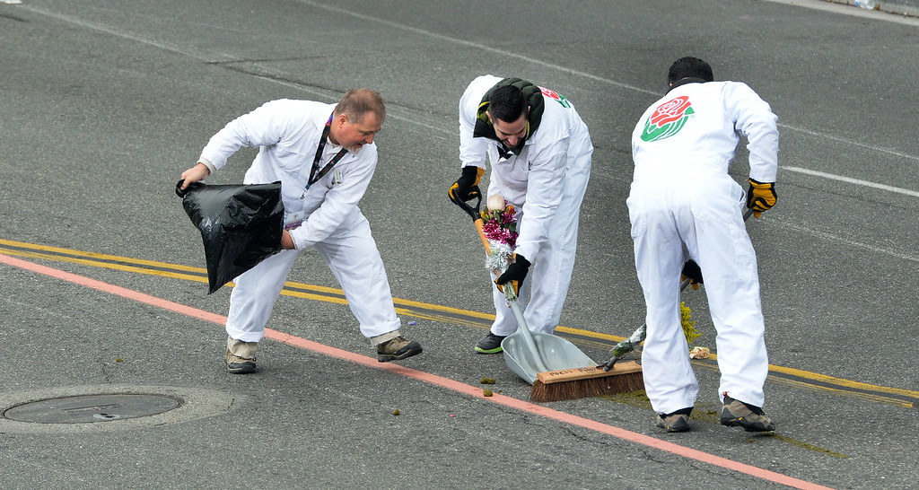 . Pooper Scoopers work during the Rose Parade on Colorado Blvd. in Pasadena, Calif. on Monday,  January 2, 2017.  (Photo by Leo Jarzomb/Pasadena Star News/SCNG)