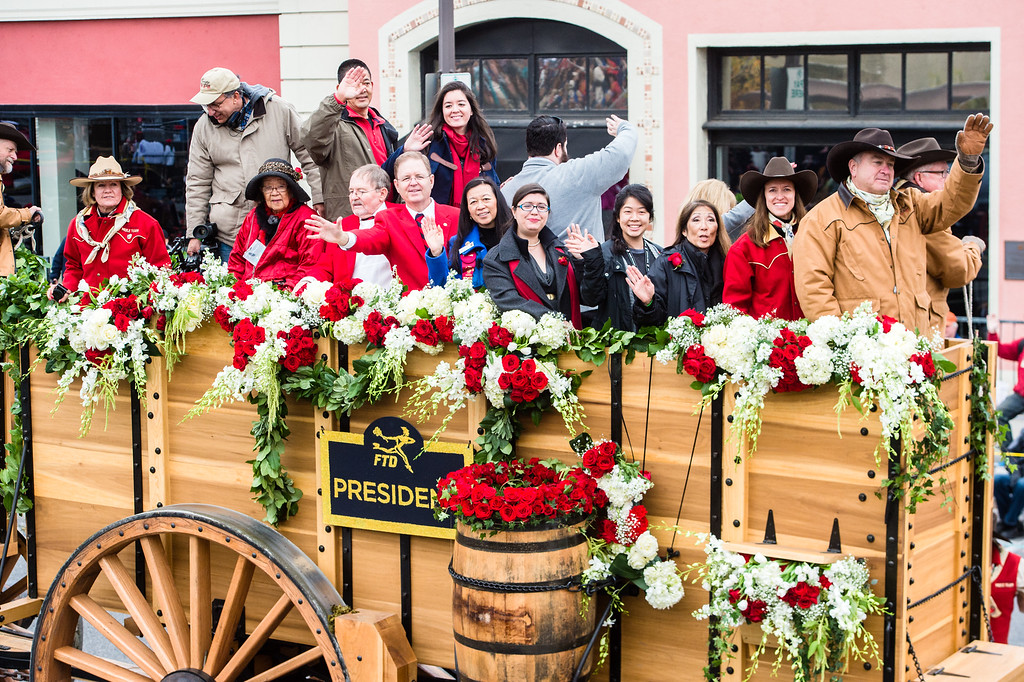 . Tournament of Roses President Brad Ratliff, his wife Susan, his father, Dick Ratliff, TofR President in 1999, and his wife Susan(cq), and family, will be pulled along the route, on freight wagons, by the Twenty Mule Borax team on Colorado Blvd. during the 2017 Rose Parade in Pasadena on Monday, January 2, 2017. (Photo by Watchara Phomicinda, San Gabriel Valley Tribune/ SCNG)