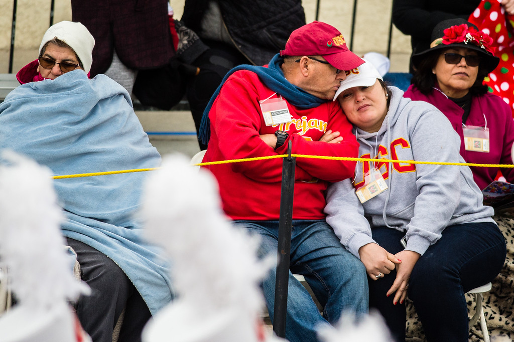 . A couple shares a moment as they watch the 2017 Rose Parade in Pasadena on Monday, January 2, 2017. (Photo by Watchara Phomicinda, San Gabriel Valley Tribune/ SCNG)