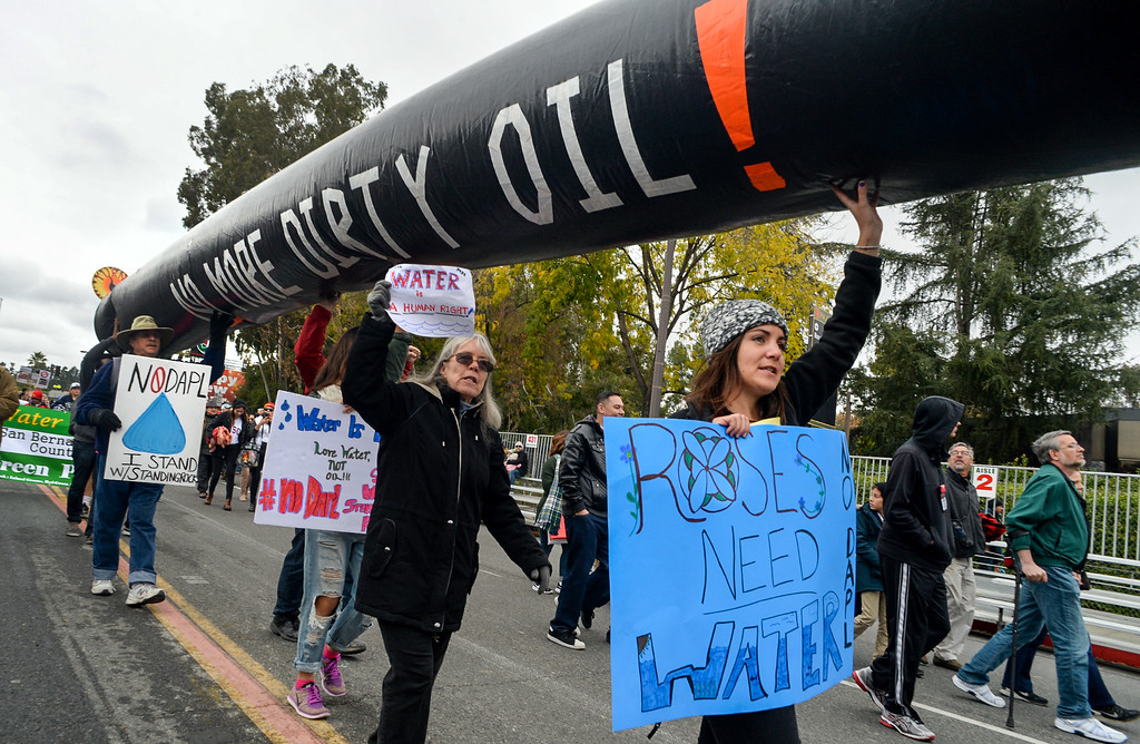 . Anti Dakota Access pipeline activists at the end of the Rose Parade on Colorado Blvd. in Pasadena, Calif. on Monday,  January 2, 2017.   (Photo by Keith Durflinger/Pasadena Star News/SCNG)