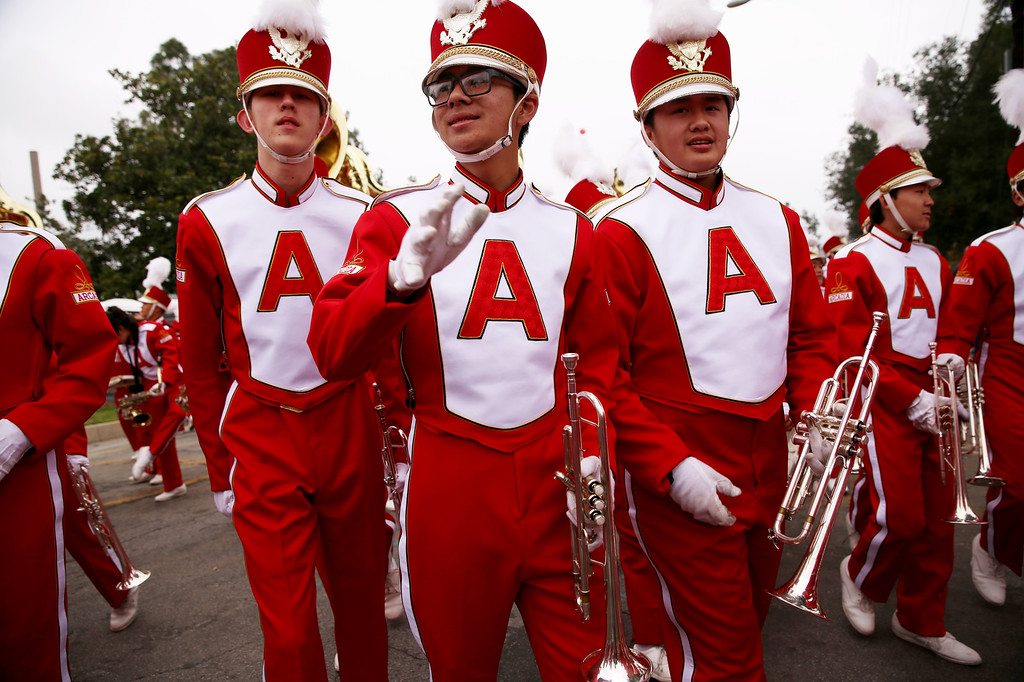 . Musicians from Arcadia celebrate after completing  the 128th Rose Parade in Pasadena, Calif. on Monday, Jan. 2, 2017. (Photo by Trevor Stamp)
