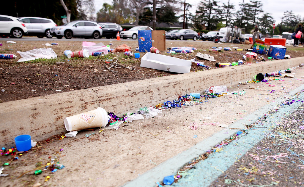 . Trash lined the parade route at the conclusion of the 128th Rose Parade in Pasadena, Calif. on Monday, Jan. 2, 2017. (Photo by Trevor Stamp)