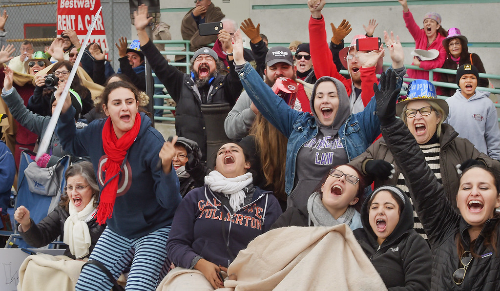 """. Rose Parade crowd having fun at the 128th Rose Parade \""""Echoes of Success\"""". (Photo by Walt Mancini/SCNG)"""