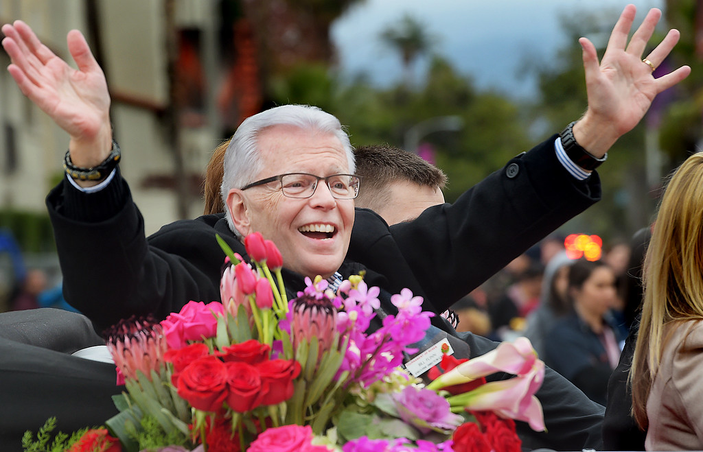 """. Bill Flynn, Tournament of Roses CEO & President  waving to crowd  at the 128th Rose Parade \""""Echoes of Success\"""". (Photo by Walt Mancini/SCNG) Flynn is retiring from the Tournament of Roses this year."""