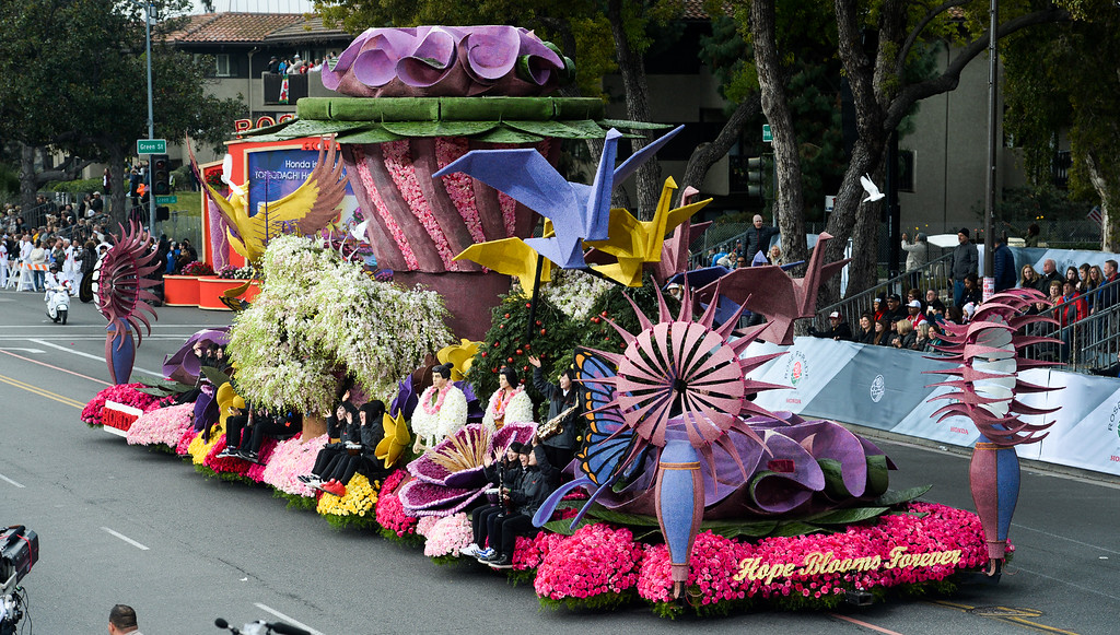 """. American Honda Motor Co. float \""""Hope Blooms Forever\"""" during the Rose Parade on Colorado Blvd. in Pasadena, Calif. on Monday,  January 2, 2017.  (Photo by Leo Jarzomb/Pasadena Star News/SCNG)"""