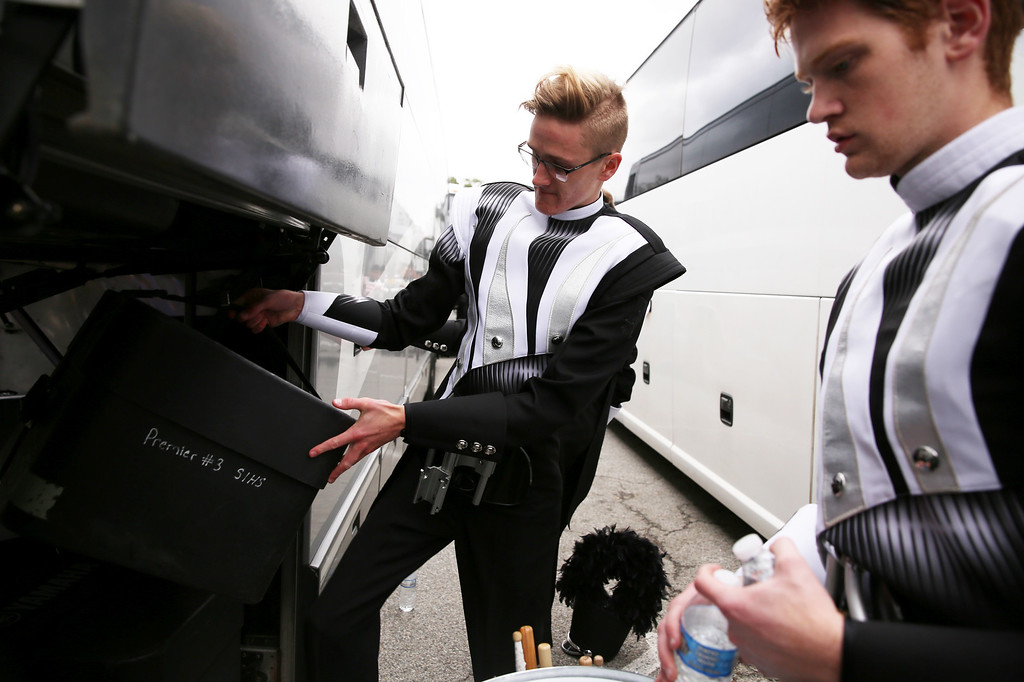 . Drummers from Broken Arrow High School place their drums inside of a bus after completing the 128th Rose Parade in Pasadena, Calif. on Monday, Jan. 2, 2017. (Photo by Trevor Stamp)