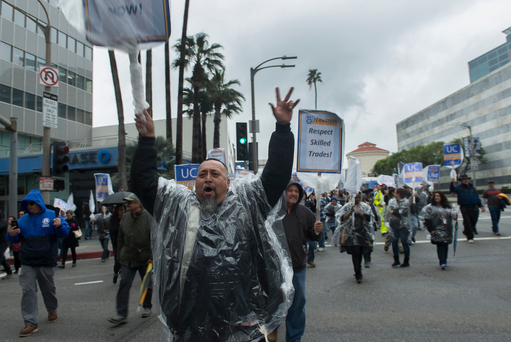 . Carlos Perez enters the intersection at Westwood Blvd. and Wilshire Blvd. to shut in down as a few hundred Teamsters Local 2010 strike in Los Angeles Tuesday, January 10, 2017. All 10 University of California campuses and five medical centers as the 12,000 UC administrative clerical and support staff protest and picket statewide. The strike is in response to the university\'s ``numerous violations of state law and unfair labor practices,\'\' contact says.(Photo by Thomas R. Cordova, L.A. Daily News/SCNG)