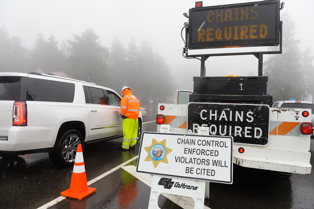 . Caltrans stops cars at a snow chain control check point near Lake Gregory Drive in the San Bernardino National Forest on Thursday, Jan. 12, 2017. A storm brought rain and snow to the Inland Empire. (Photo by Rachel Luna/The Sun, SCNG)