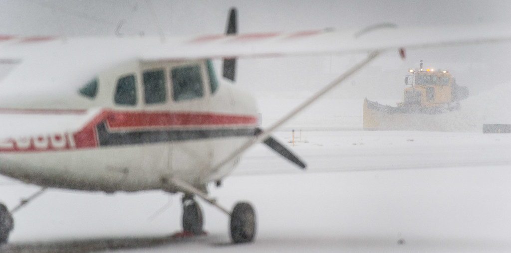 . Snow plows in continuous operation keep the runway clear at the Big Bear City Airport during a snowstorm in Big Bear City, Thursday, Jan. 12, 2017. (Eric Reed/For The Sun/SCNG)