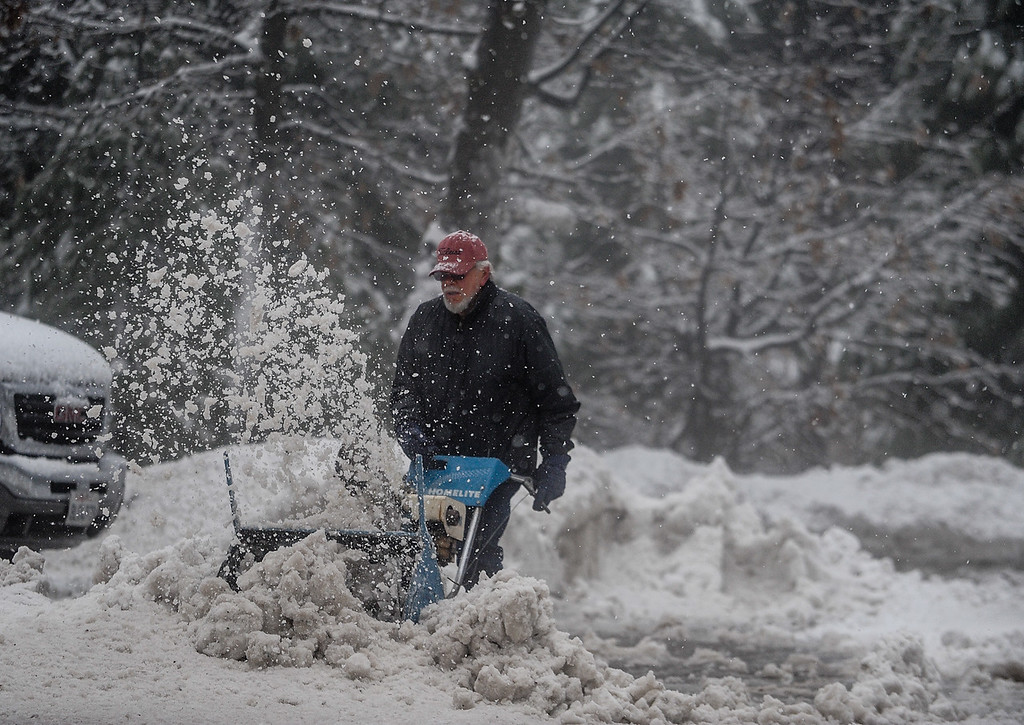 . A man plows snow out of his driveway as heavy snow falls in Twin Peaks, Calif. on Thursday, Jan. 12, 2017. A storm brought rain and snow to the Inland Empire. (Photo by Rachel Luna/The Sun, SCNG)