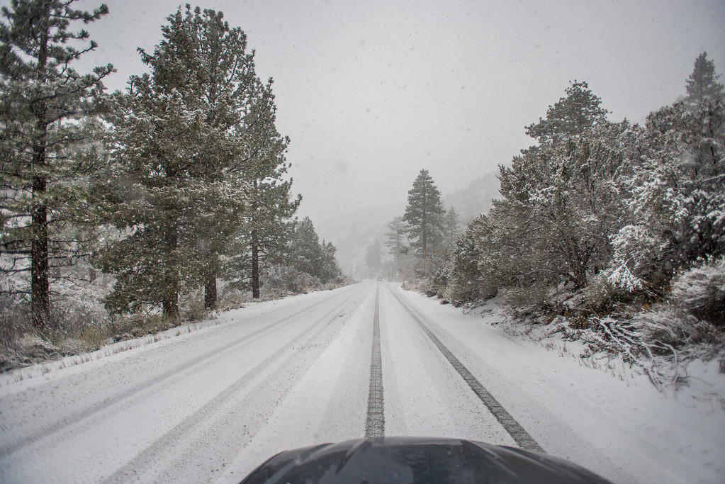 . An open, but snow-covered road at Onyx Summit on Highway 38 during a snowstorm in the San Bernardino National Forest near Big Bear, Thursday, Jan. 12, 2017. (Eric Reed/For The Sun/SCNG)
