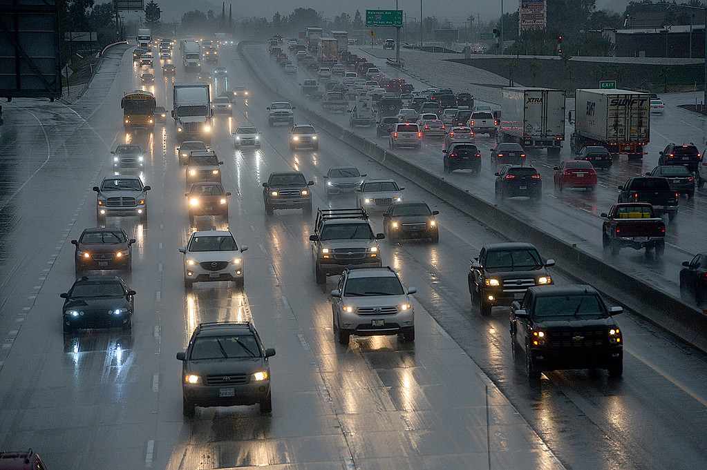 . Rain and wet freeway surfaces slows the afternoon commute along the eastbound 10 freeway through Loma Linda Thursday, January 12, 2017. Rain, heavy at times, hit the Inland Empire and surrounding areas on Thursday, January 12, 2017. The forecast Friday, according to the National Weather Service, through the weekend is sunny with the high near 56 for Friday and in the 60\'s during the weekend. (Staff photo by Rick Sforza/Redlands Daily Facts, SCNG)