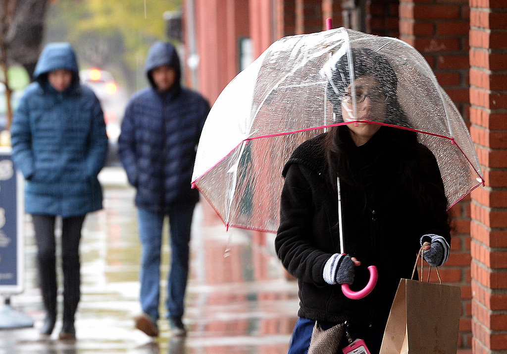 . Pedestrians, braving the wet weather, make their around downtown Redlands Thursday, January 12, 2017. Rain, heavy at times, hit the Inland Empire and surrounding areas on Thursday, January 12, 2017. The forecast Friday, according to the National Weather Service, through the weekend is sunny with the high near 56 for Friday and in the 60\'s during the weekend. (Staff photo by Rick Sforza/Redlands Daily Facts, SCNG)