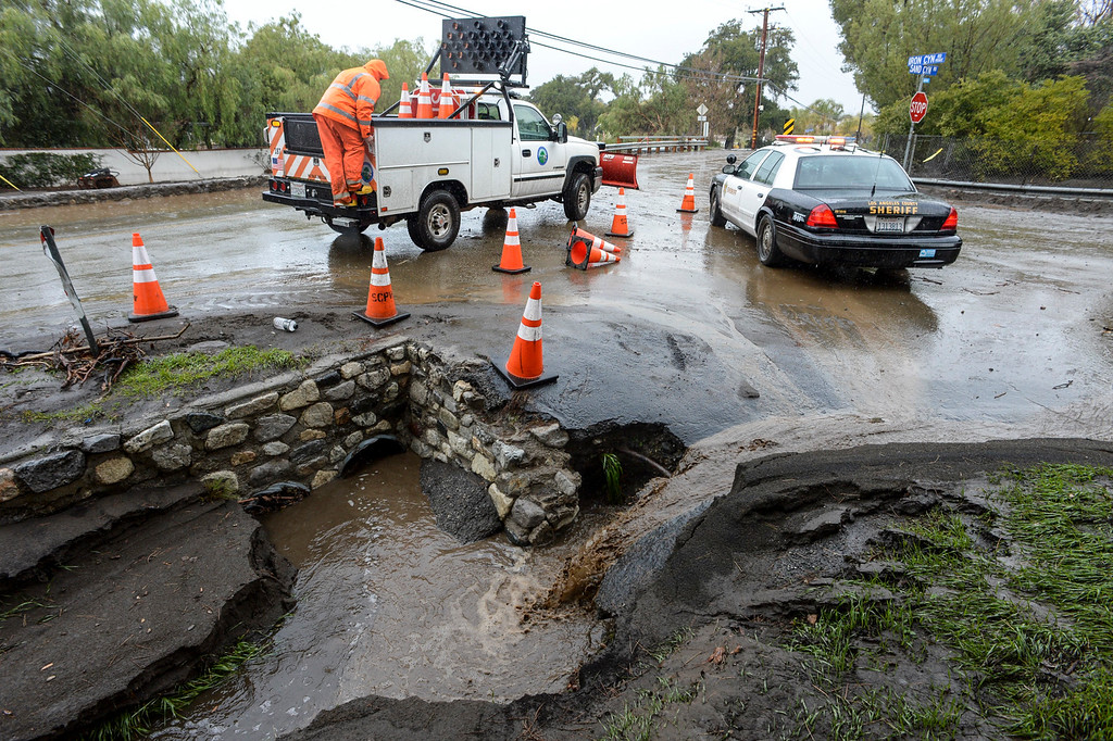 . Water flows down the embankment at Iron Canyon road and Sand Canyon road in Santa Clarita Sunday morning as heavy rain falls in the area.   (Photo by David Crane, Los Angeles Daily News/SCNG)