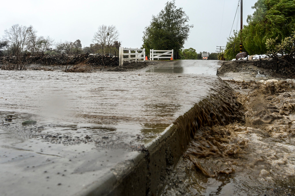 . Water flows over Road Runner lane near Sand Canyon in Santa Clarita Sunday as heavy rain falls in the area.   (Photo by David Crane, Los Angeles Daily News/SCNG)