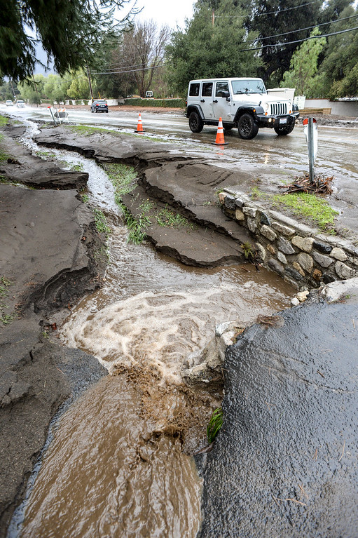 . Water and mud flow along Sand Canyon road near Iron Canyon road in Santa Clarita Sunday as heavy rain falls in the area.   (Photo by David Crane, Los Angeles Daily News/SCNG)