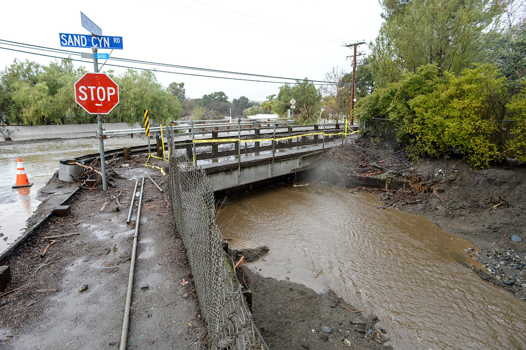 . Water nears the top of the bridge at Iron Canyon and Sand Canyon road in Santa Clarita Sunday morning as heavy rain falls in the area.   (Photo by David Crane, Los Angeles Daily News/SCNG)