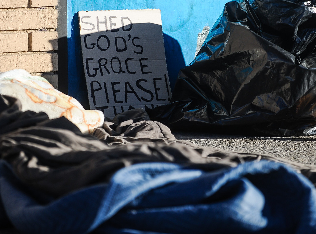 . A sign is displayed next to an individual\'s makeshift homeless camp in front of a business in San Bernardino, Calif. on Thursday, Jan. 26, 2017. San Bernardino County Sheriff\'s HOPE team and the San Bernardino County Homeless Partnership spend the morning talking to and counting homeless individuals throughout the city and San Bernardino County in order to develop current and future services that serve the homeless population. (Photo by Rachel Luna/The Sun, SCNG)