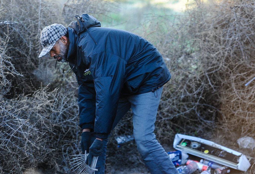 . Wesley Burroughs, a 40-year-old homeless man from Redlands, cleans his camp space after being counted by the San Bernardino County Sheriff\'s HOPE team near Seccombe Lake Park in San Bernardino, Calif. on Thursday, Jan. 26, 2017. San Bernardino County Sheriff\'s HOPE team and the San Bernardino County Homeless Partnership spend the morning talking to and counting homeless individuals throughout the city and San Bernardino County in order to develop current and future services that serve the homeless population. (Photo by Rachel Luna/The Sun, SCNG)
