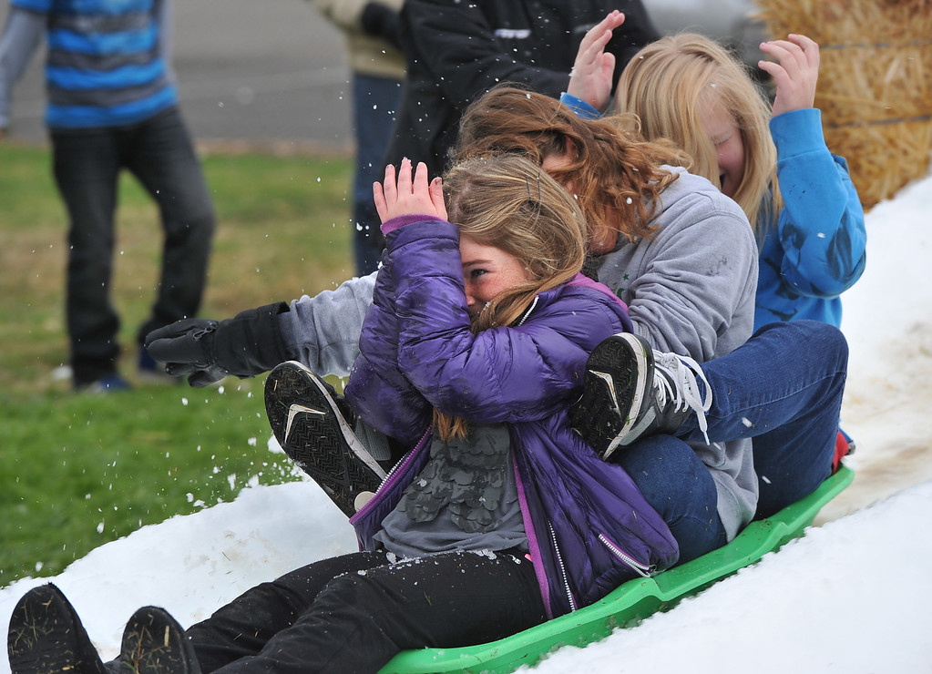. Fifth graders sled and shield themselves from snowballs at Bethany Lutheran School where 10 tons of snow was delivered Thursday to  thank students for a successful jog-a-thon.  Long Beach January 30, 2014. (Photo by Brittany Murray / Press Telegram)
