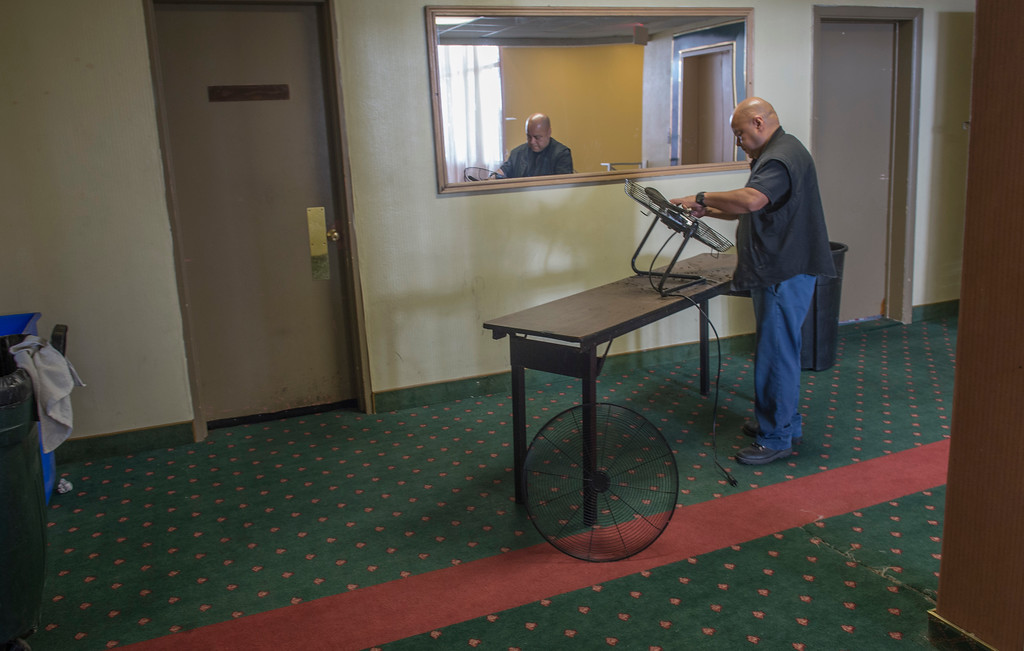 . Jose Hernandez, an employee, cleans the dust of a fan while working at the Seaport Marina Hotel which shut its doors this week in Long Beach Wednesday, February 1, 2017. The 54-year-old hotel, which sits at the gateway to Long Beach from its OC border with Seal Beach, has fallen into disrepair over the years. (Photo by Thomas R. Cordova, Press-Telegram/SCNG)