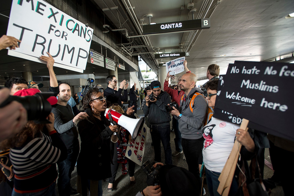 . Candance Camper, left, a supporter of President Donald J. Trump, confronts an anti-Trump protestor during Make America Safe Again Rally at Tom Bradley International Terminal, Los Angeles International Airport in Los Angeles on Saturday, February 04, 2017. (Photo by Ed Crisostomo, Los Angeles Daily News/SCNG)