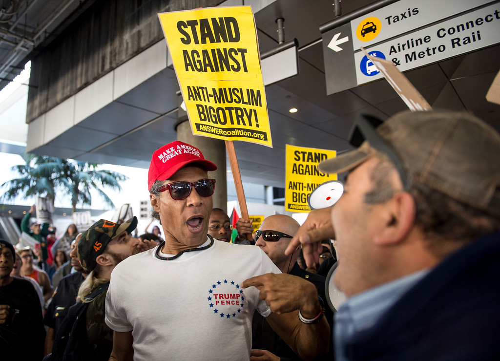 . A supporter of President Donald J. Trump, left, confronts an anti-Trump protestor during Make America Safe Again Rally at Tom Bradley International Terminal, Los Angeles International Airport in Los Angeles on Saturday, February 04, 2017. (Photo by Ed Crisostomo, Los Angeles Daily News/SCNG)