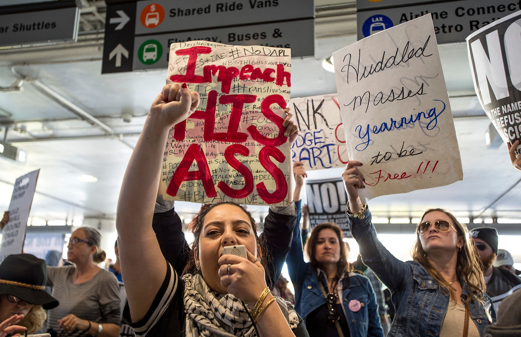 . Anti Trump protestors gather and chant across the street from supporters of President Donald J. Trump rally at Tom Bradley International Terminal, Los Angeles International Airport in Los Angeles on Saturday, February 04, 2017. (Photo by Ed Crisostomo, Los Angeles Daily News/SCNG)