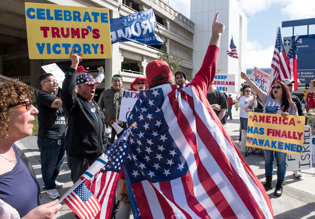 . Supporters of President Donald J. Trump, gather and chant during Make America Safe Again Rally at Tom Bradley International Terminal, Los Angeles International Airport in Los Angeles on Saturday, February 04, 2017. (Photo by Ed Crisostomo, Los Angeles Daily News/SCNG)