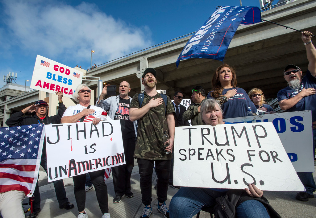 ". Supporters of President Donald J. Trump gather and sing ""God Bless America\"" during Make America Safe Again Rally at Tom Bradley International Terminal, Los Angeles International Airport in Los Angeles on Saturday, February 04, 2017. (Photo by Ed Crisostomo, Los Angeles Daily News/SCNG)"