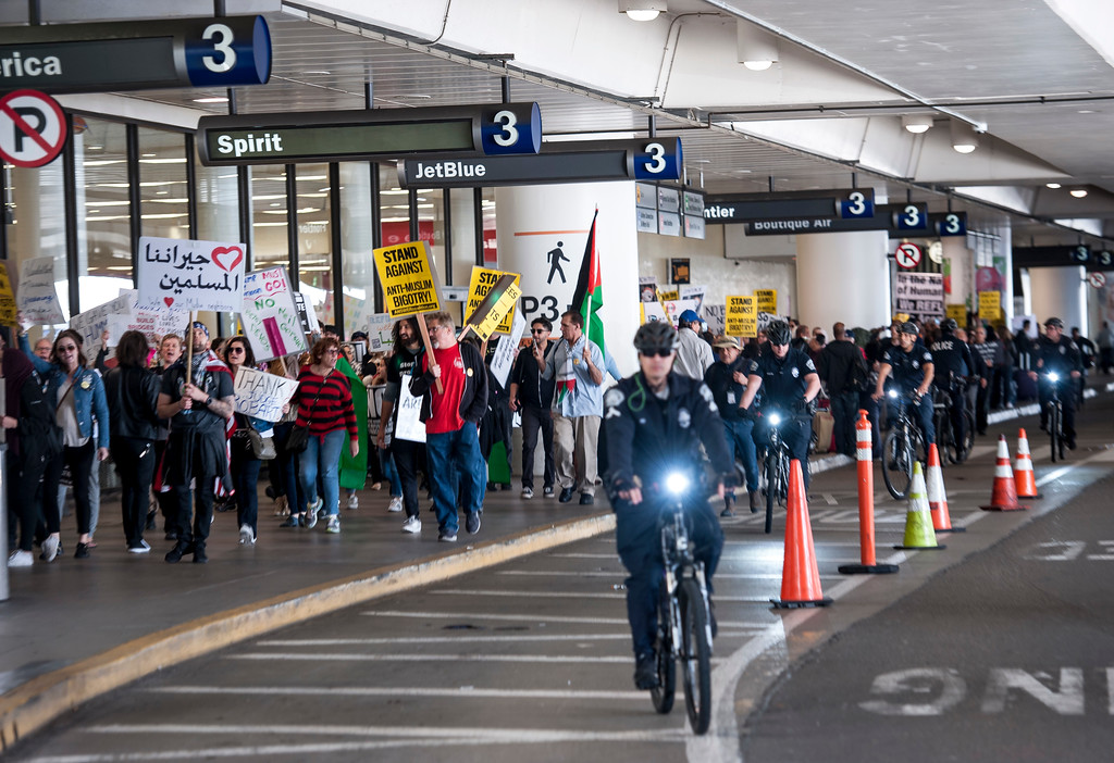 . Anti Trump protestors march along at Tom Bradley International Terminal, Los Angeles International Airport in Los Angeles on Saturday, February 04, 2017. (Photo by Ed Crisostomo, Los Angeles Daily News/SCNG)