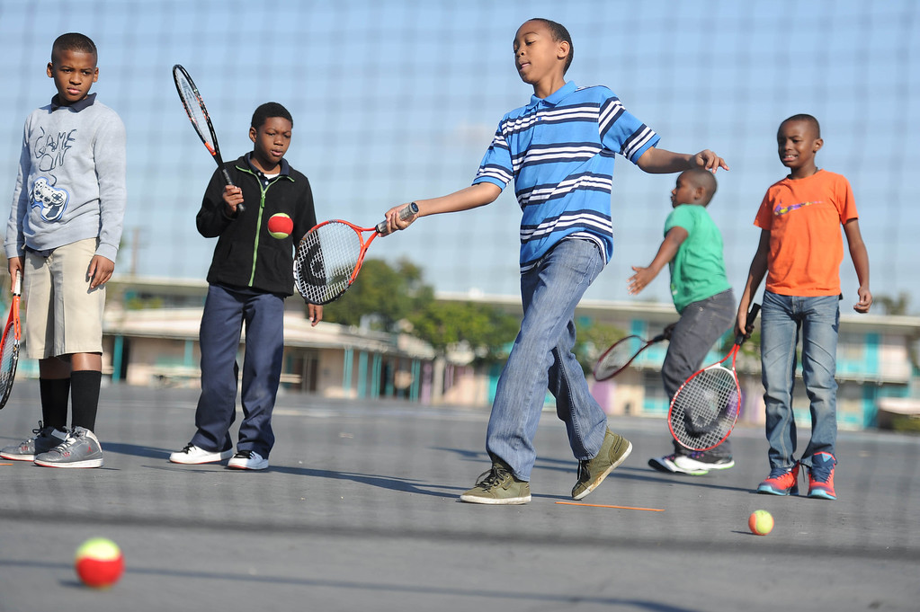 . Jalen Jones practices his swing at Leapwood Elementary Wednesday as part of an outreach program by a local tennis academy Ramp Tennis in Carson , CA. on Wednesday, February 05, 2014. (Photo by Sean Hiller/ Daily Breeze).