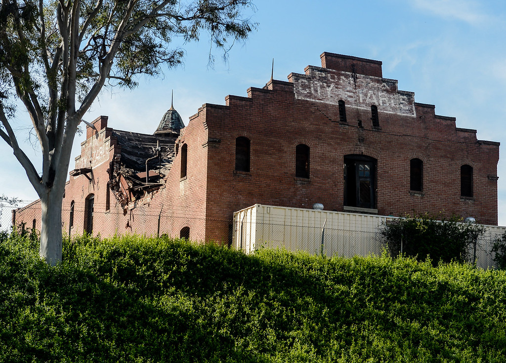 . The historic Pomona City Stables building is pictured crumbling on site near White Avenue in Pomona on Thursday, Feb. 9, 2017. The city blocked traffic from going down the street on Wednesday, and since the building is on the Nation Register of Historic Places, the city has been in contact with historic preservation experts and structural engineers to determine the the appropriate course of action, according to city officials. (Photo by Rachel Luna/Inland Valley Daily Bulletin, SCNG)