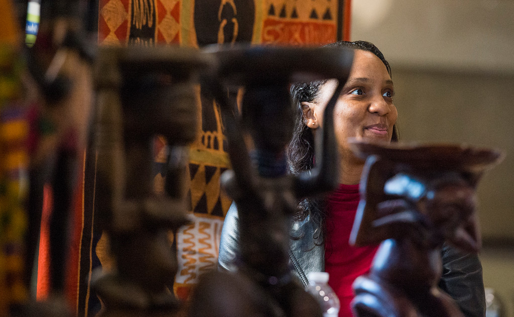 . Jeanetta Wright sits at a table near West African statues at the Long Beach Black History Month celebration titled �Rich History, Bright Future� at city hall in Long Beach Tuesday, February 14, 2017. (Photo by Thomas R. Cordova, Press-Telegram/SCNG)