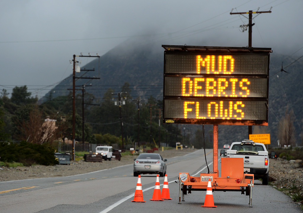 . A sign, warning about possible mud and debris flow in the recent Blue Cut Fire burn area, sits along Lytle Creek Road in Fontana, CA., Friday, February 17, 2017. (Staff photo by Jennifer Cappuccio Maher/The Sun/SCNG)