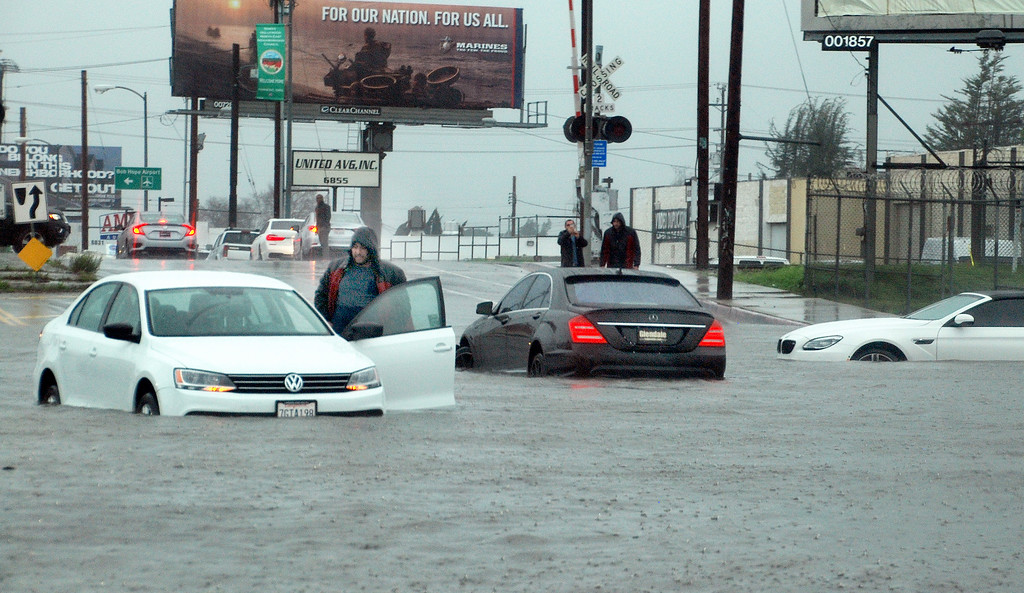 . Three cars are flooded on Vineland Ave.  between Vanowen St. and Sherman Way in North Hollywood, on Friday, February 17, 2017.  The man on the left is just getting out of  his car. LAFD had assisted drivers of the others vehicles to dry land. (Photo by MikeMeadows, Special to the Los Angeles Daily News)