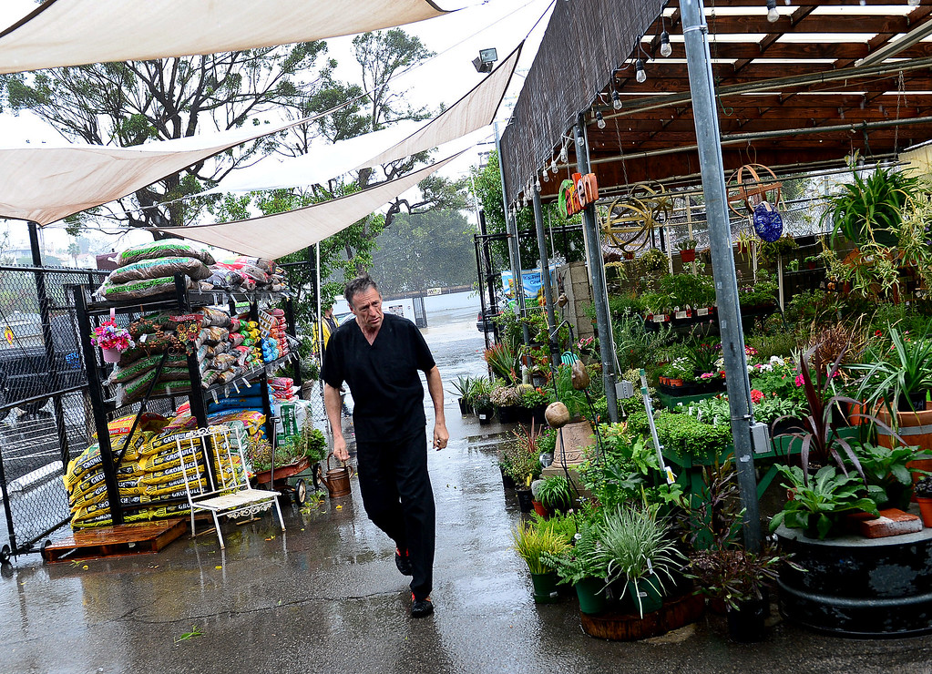 . Customer Mark Wakefield walks during heavy rain at Franklin\'s Hardware store in Woodland Hills on Friday, February 17, 2017.  (Photo by Dean Musgrove, Los Angeles Daily News/SCNG)