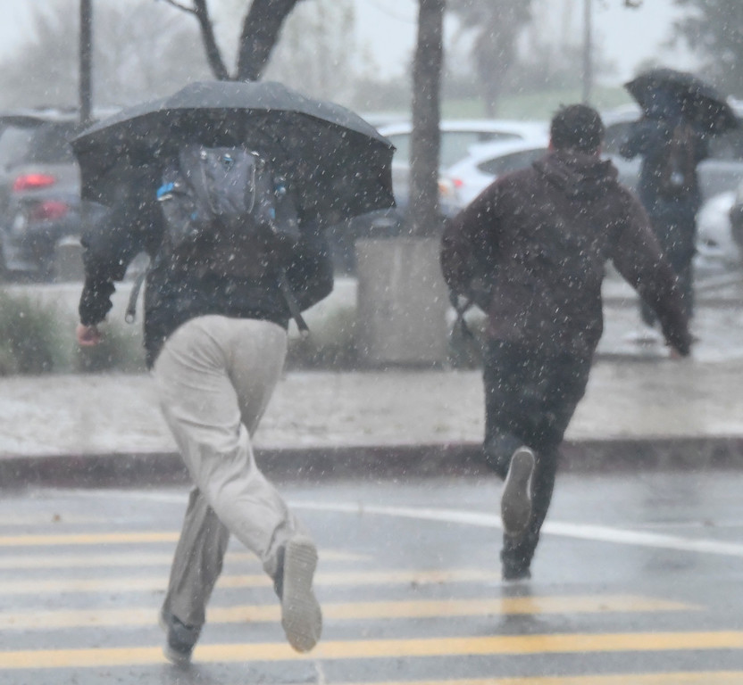 . Feb 17,2017. Van Nuys Ca. Students getting out of Birmingham High school make a run in the heavy rain from todays most powerful storm to hit the Southland in seven years is moving across the region, bringing heavy winds, snow and torrential rain that has raised the specter of flash flooding.   Photo by Gene Blevins/LA DailyNews/SCNG