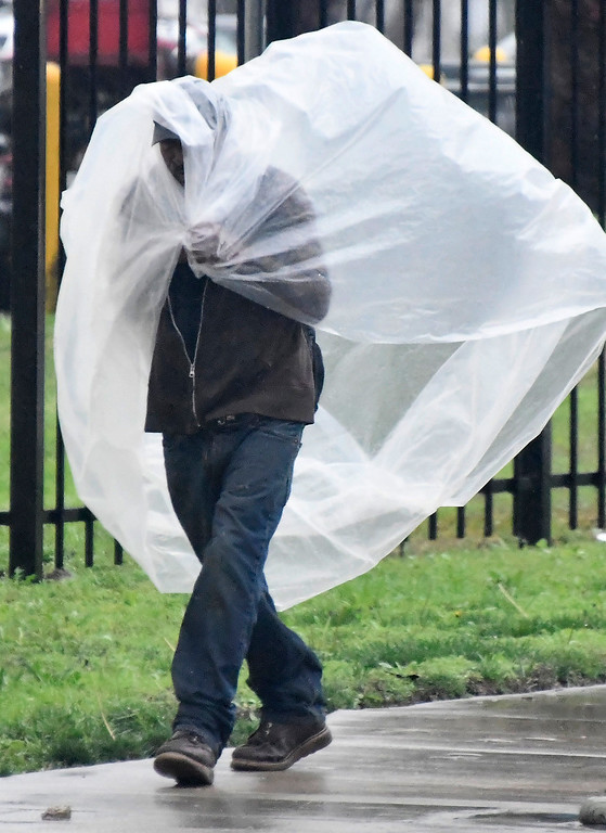 . Feb 17,2017. van nuys Ca.  A man used a plastic sheet to keep try from todays powerful storm to hit the Southland in seven years is moving across the region, bringing heavy winds, snow and torrential rain that has raised the specter of flash flooding.   Photo by Gene Blevins/LA DailyNews/SCNG