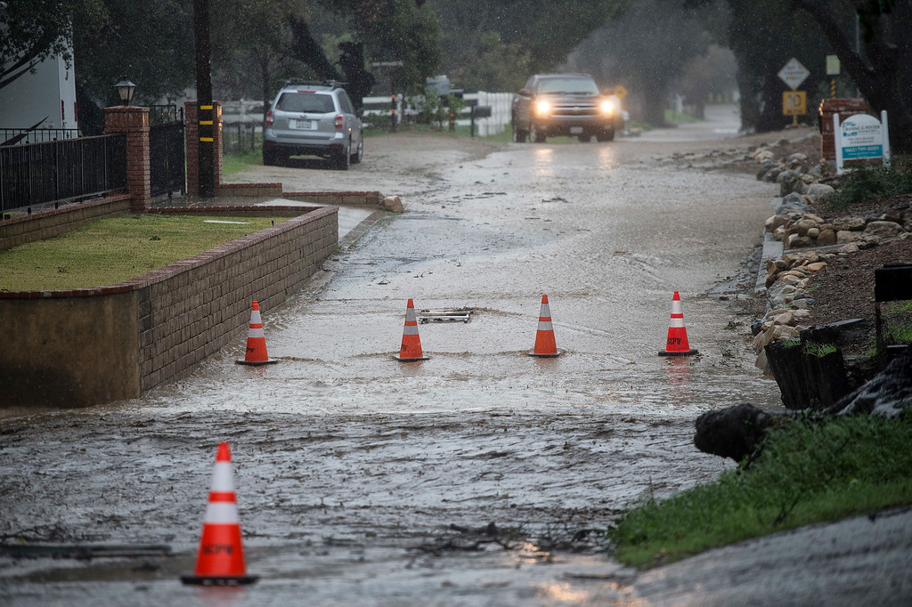 . Water covers Quigley Canyon Rd Santa Clarita, making it impassable to vehicles, Friday, February 17, 2017.    (Photo by Hans Gutknecht, Los Angeles Daily News/SCNG)
