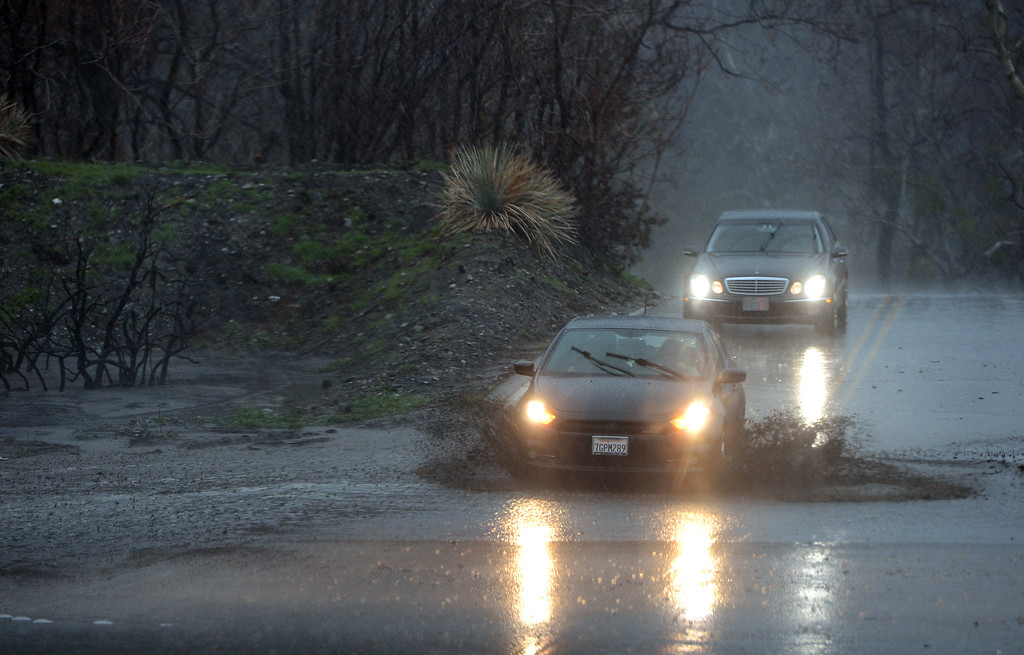 . Motorists cross rising rain run-off on Lytle Creek Road in the Blue Cut Fire burn area in Lytle Creek, CA., Friday, February 17, 2017. (Staff photo by Jennifer Cappuccio Maher/The Sun/SCNG)