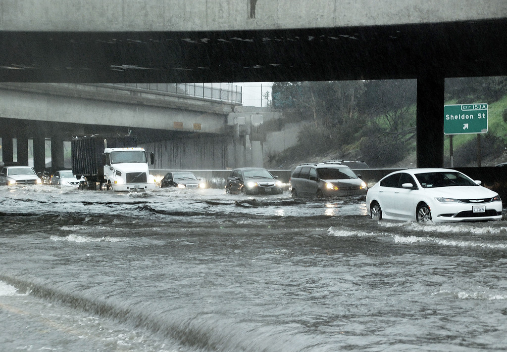 . The I-5 at Sheldon St. in Sun Valley is severly flooded from heavy rain and runoff. Only one lane was open and there were numerous flooded cars stranded on the freeway.  CHP closed the freeway for a time on Friday, February 17, 2017.  (Photo by Mike Meadows, Special to the Los Angeles Daily News)